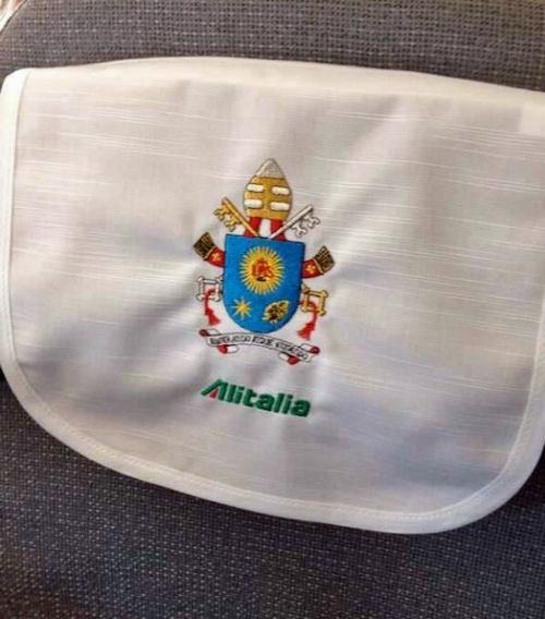 Hoofdsteunovertrek in het pauselijke vliegtuig